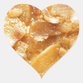 Macro of almond splitters on a cake heart sticker