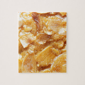 Macro of almond splitters on a cake jigsaw puzzle