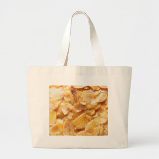 Macro of almond splitters on a cake large tote bag