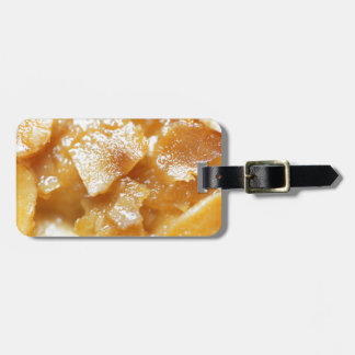 Macro of almond splitters on a cake luggage tag