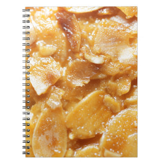 Macro of almond splitters on a cake notebook