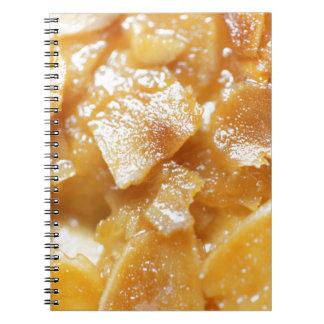 Macro of almond splitters on a cake notebooks