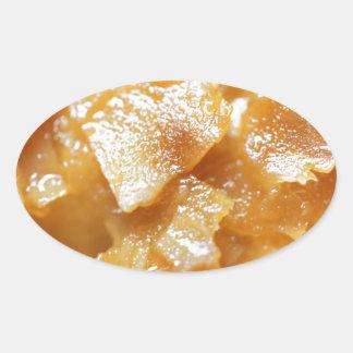 Macro of almond splitters on a cake oval sticker