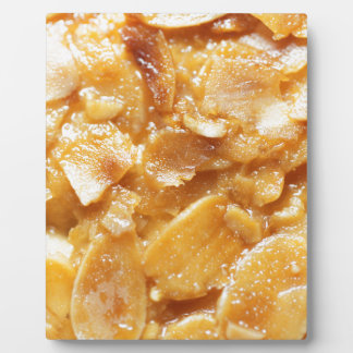 Macro of almond splitters on a cake plaque