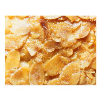 Macro of almond splitters on a cake postcard
