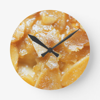 Macro of almond splitters on a cake round clock