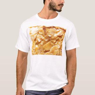 Macro of almond splitters on a cake T-Shirt