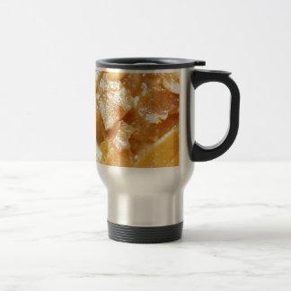 Macro of almond splitters on a cake travel mug