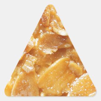 Macro of almond splitters on a cake triangle sticker