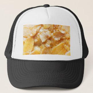 Macro of almond splitters on a cake trucker hat