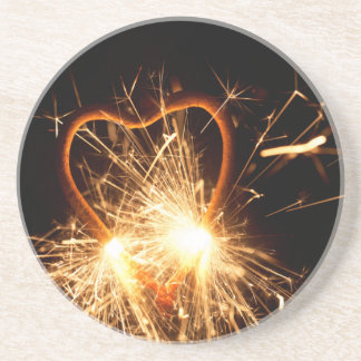 Macro photo of a burning sparkler in form of a hea coaster