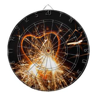 Macro photo of a burning sparkler in form of a hea dartboard