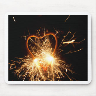 Macro photo of a burning sparkler in form of a hea mouse pad