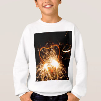 Macro photo of a burning sparkler in form of a hea sweatshirt