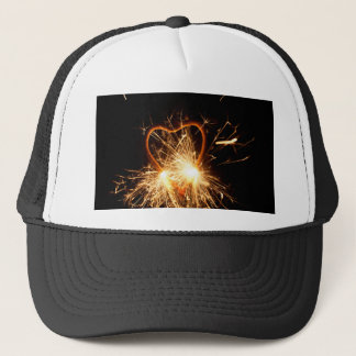 Macro photo of a burning sparkler in form of a hea trucker hat