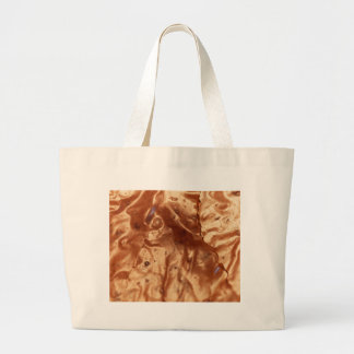 Macro photo of a chocolate cover of a cake. large tote bag