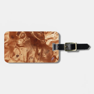 Macro photo of a chocolate cover of a cake. luggage tag