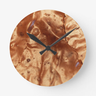 Macro photo of a chocolate cover of a cake. round clock