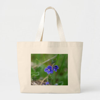 Macro photo of a  german speedwell large tote bag