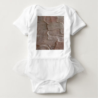 Macro photo of pine bark baby bodysuit