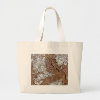 Macro photo of the surface of brown bread from Ger Large Tote Bag