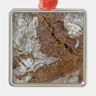 Macro photo of the surface of brown bread from Ger Metal Ornament