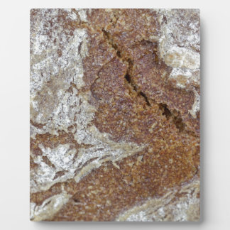 Macro photo of the surface of brown bread from Ger Plaque