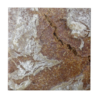 Macro photo of the surface of brown bread from Ger Small Square Tile