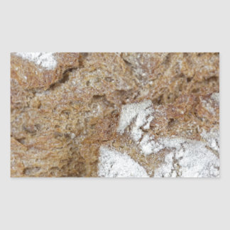Macro photo of the surface of brown bread rectangular sticker
