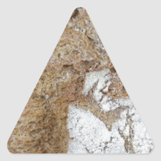 Macro photo of the surface of brown bread triangle sticker