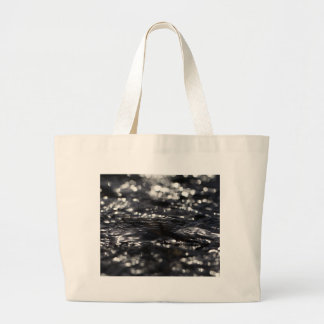 Macro photo of the surface of water in a creek large tote bag