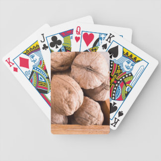 Macro view of a group of old walnuts bicycle playing cards