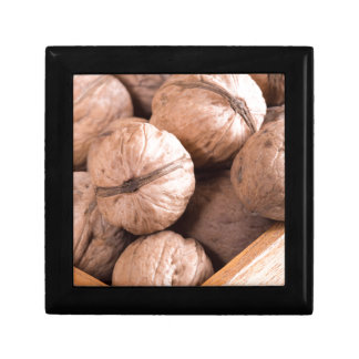Macro view of a group of walnuts in a wooden box