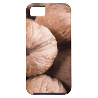 Macro view of a group of walnuts in a wooden box tough iPhone 5 case