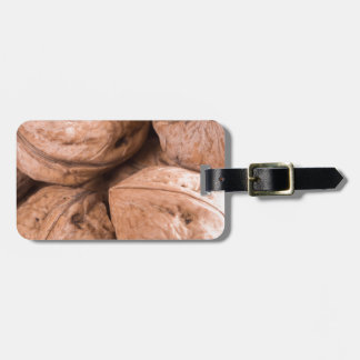 Macro view of a group of walnuts luggage tag