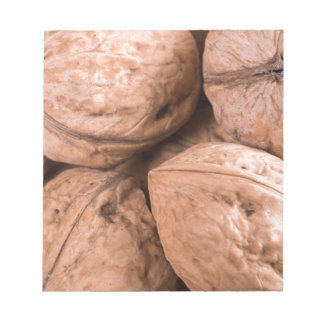 Macro view of a group of walnuts notepad