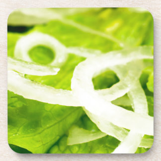 Macro view of the leaves of lettuce and onion ring coaster