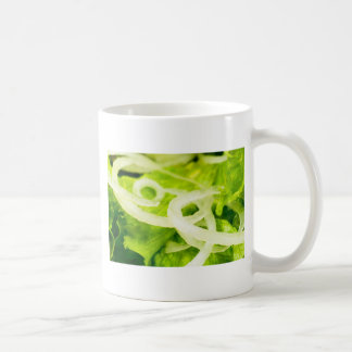 Macro view of the leaves of lettuce and onion ring coffee mug