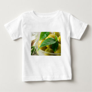 Macro view of the olives with green leaves closeup baby T-Shirt