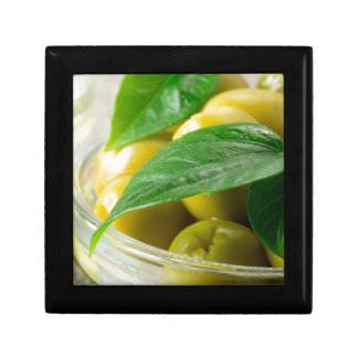 Macro view of the olives with green leaves closeup gift box