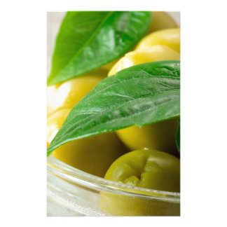 Macro view of the olives with green leaves closeup stationery