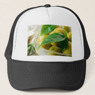 Macro view of the olives with green leaves closeup trucker hat