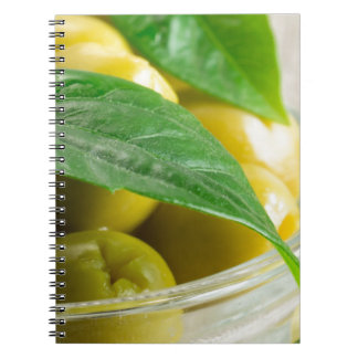 Macro view of the olives with green leaves notebook