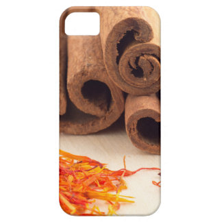 Macro view of the sticks of cinnamon and saffron barely there iPhone 5 case