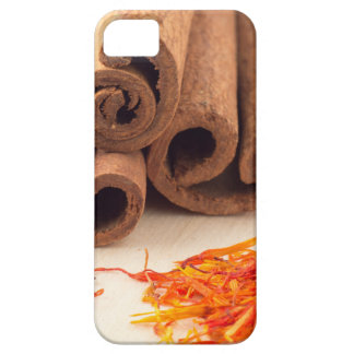 Macro view of the sticks of cinnamon and saffron iPhone 5 cover