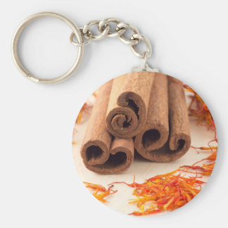 Macro view of the sticks of cinnamon and saffron key ring