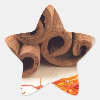 Macro view of the sticks of cinnamon and saffron star sticker