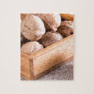 Macro view of walnuts close up in a wooden box jigsaw puzzle