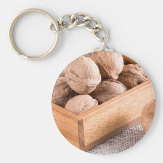 Macro view of walnuts close up in a wooden box key ring