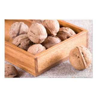 Macro view of walnuts close up in a wooden box photo print